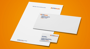 UVA Health stationery on orange background